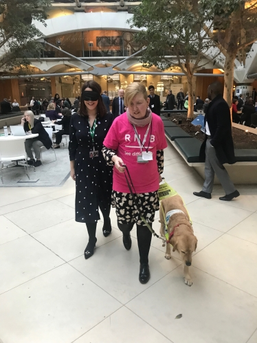 Fay Jones MP with a guide dog